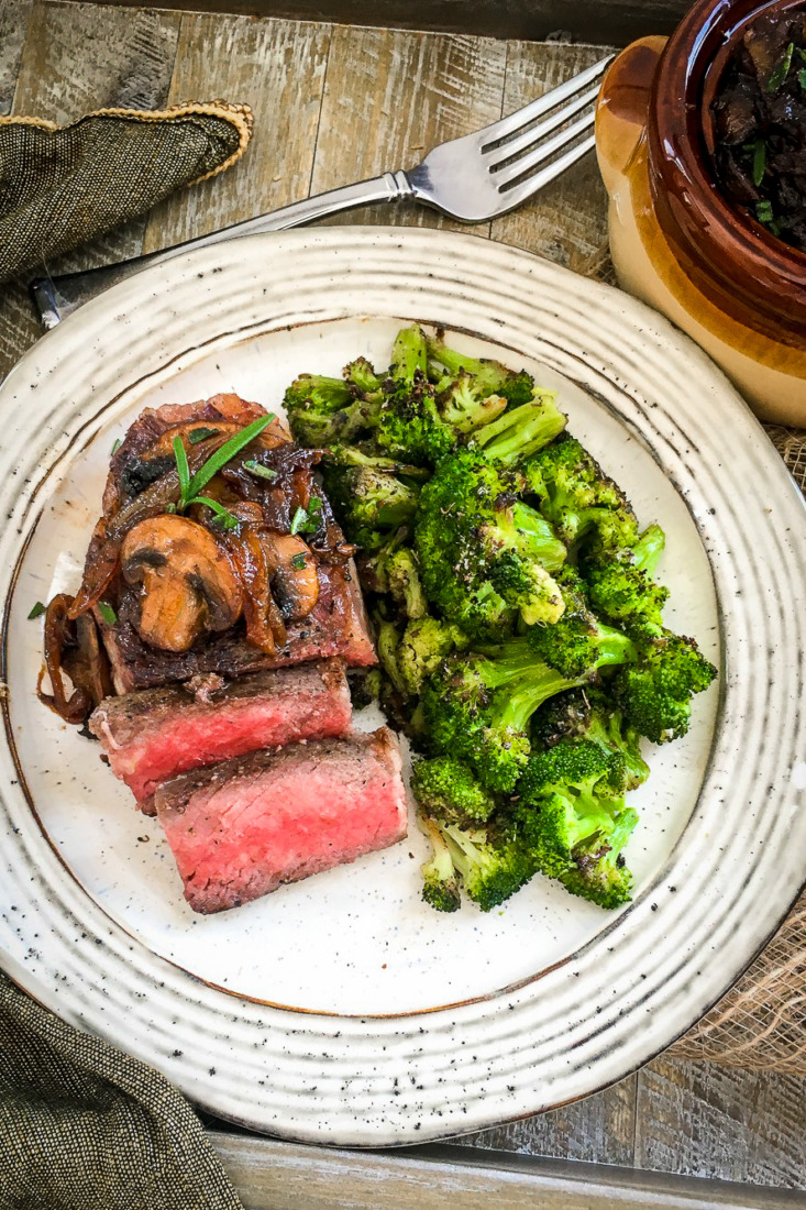 Enjoy a restaurant quality family meal you can easily make at home with this Sous Vide Strip Steak with Carmelized Onions & Mushrooms.