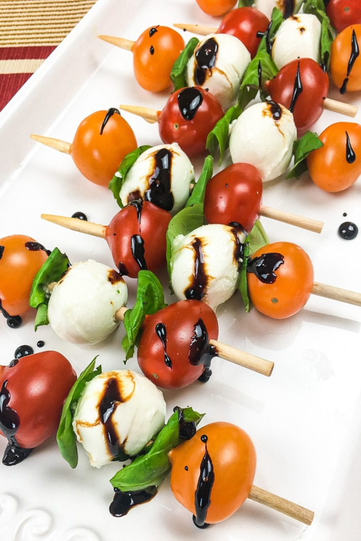 These Caprese Skewers with a Balsamic Glaze are a classic appetizer recipe. They are a caprese salad on a stick, always a favourite!