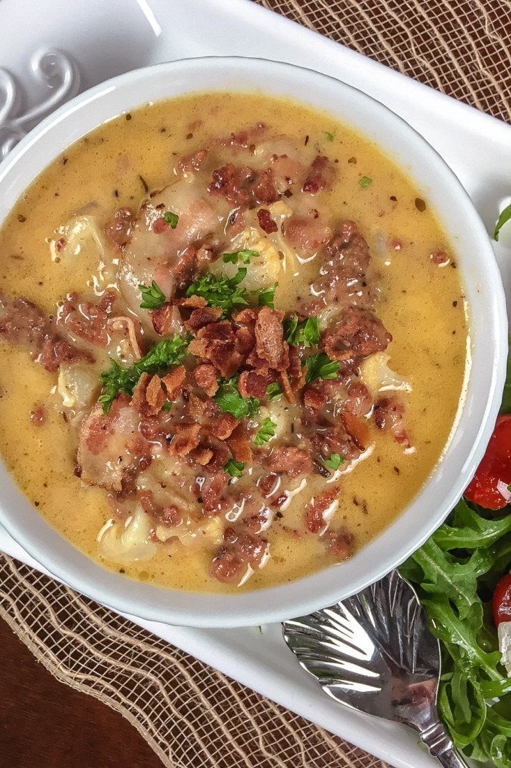 This One Pot Keto Bacon Cheeseburger soup is filled with ground beef, cheese, cauliflower, and bacon for a filling and tasty meal.