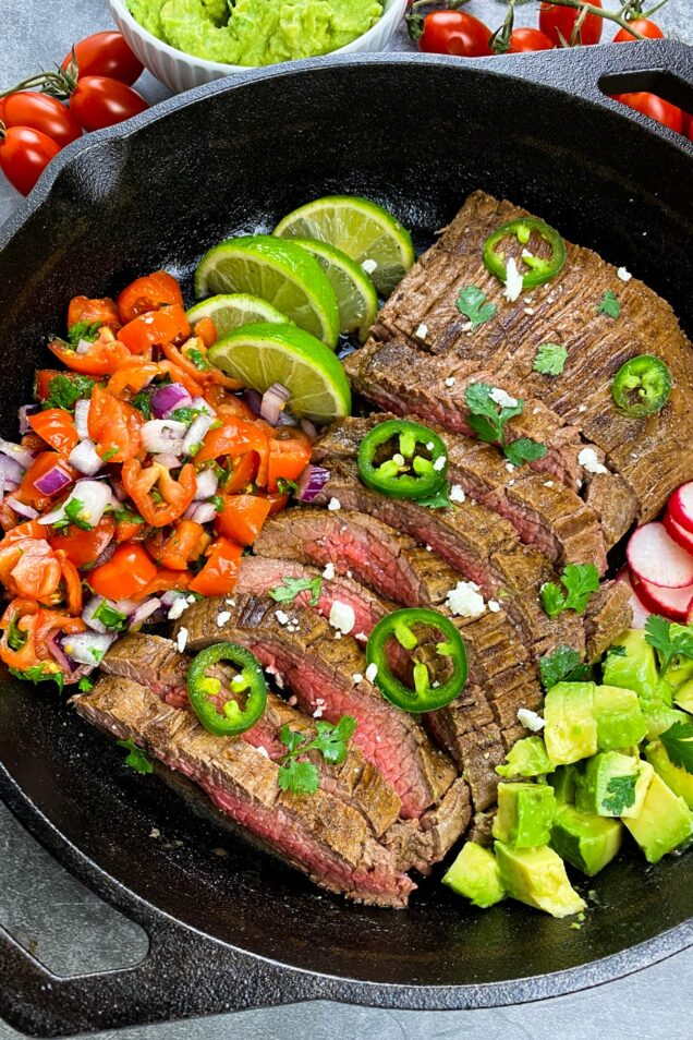 This Skillet Carne Asada features a steak marinated in a perfect combination of citrus, chili and cilantro for the most flavourful tacos.