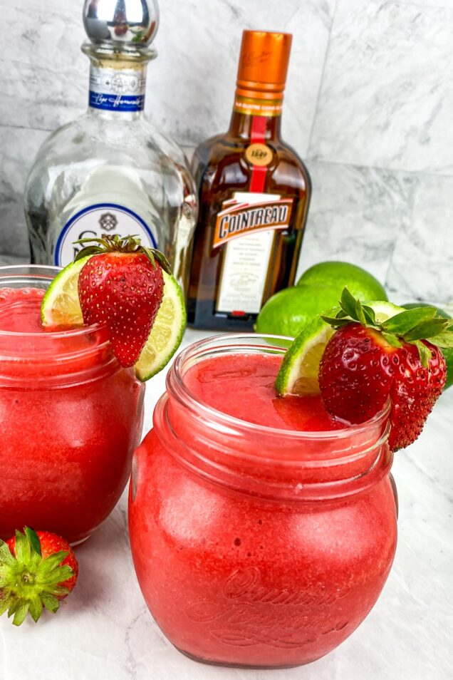 Make this refreshing 5 ingredient Chili's Frozen Strawberry Margarita Recipe in a blender in under 5 minutes. Serve it all summer long!