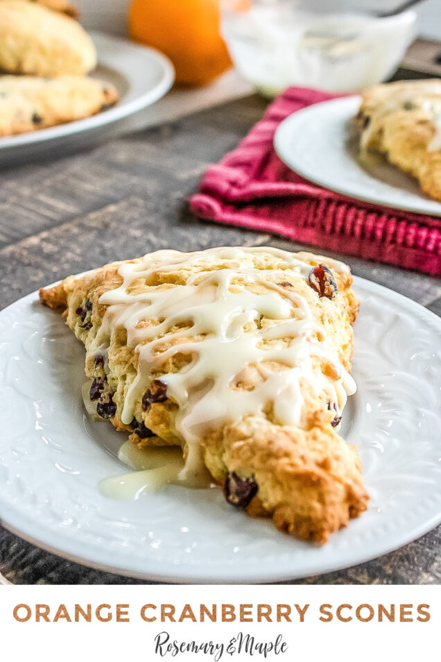 This Cranberry Orange Scone recipe is a Starbucks copycat that features dried cranberries and orange zest, drizzled with orange icing.