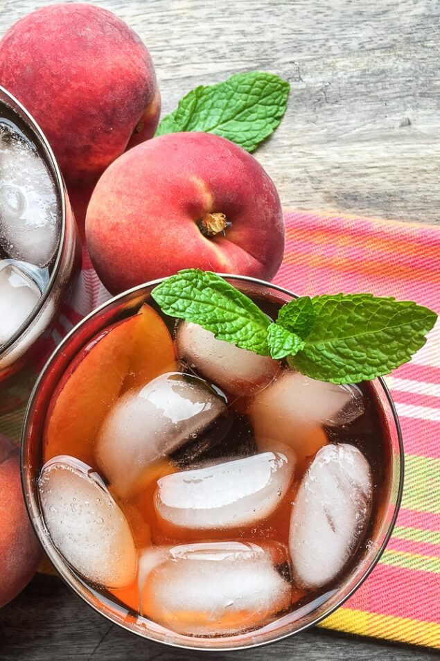 This refreshing, summer-ready ginger-peach iced tea recipe is made with fresh peaches in an instant pot, it's ready in under 30 minutes.