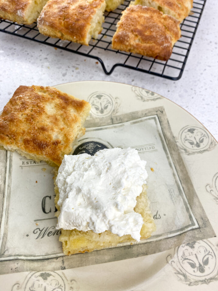 shortcakes cut in half with whipped cream.