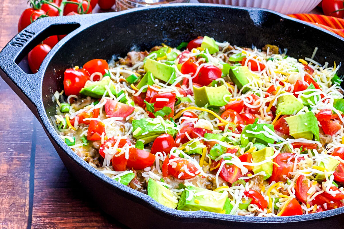 This recipe for an easy beef taco skillet makes a hearty family meal or serve with tortilla chips instead for an addictive appetizer!