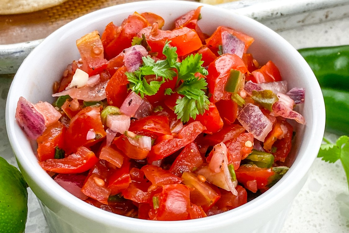 This quick and easy copycat Chipotle Pico de Gallo Recipe is made with fresh tomatoes, red onions, cilantro, serrano peppers and lime juice.